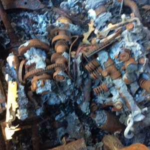 Burned Out Arctic Cat Wildcat Trail   cause of fire   showing condition of motor and guts of mac