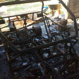 Burned Out Arctic Cat Wildcat Trail   cause of fire   showing roll up door location of burned Ro